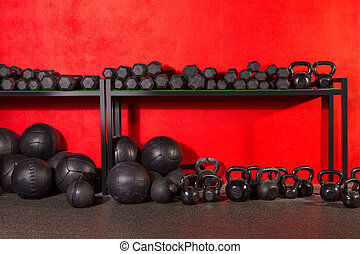 Kettlebell dumbbell and weighted balls at gym - Kettlebell...