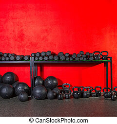 Kettlebell dumbbell and weighted balls at gym - Kettlebells...