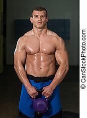 kettlebell, muscular, ejercicio, hombre