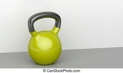 Kettlebell on shiny gray floor in the fitness centre