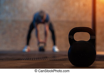 Kettlebell on the background of male athlete