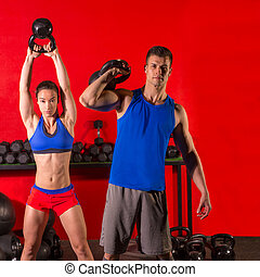 Kettlebell swing workout training group at gym