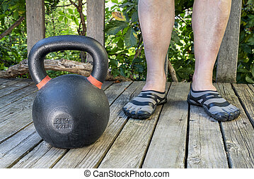 kettlebell workout in backyard, home fitness concept