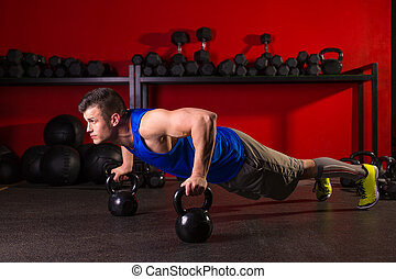 Kettlebells push-up man strength gym workout - Kettlebells...