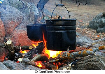 Kettles over the campfire