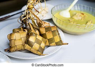 ketupat for eid mubarak feast celebration in indonesian...