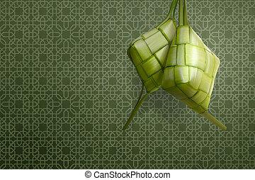 Ketupat is traditional food for eid celebration over green...
