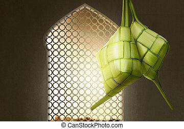 Ketupat or rice dumpling for Eid Mubarak with sunset view...