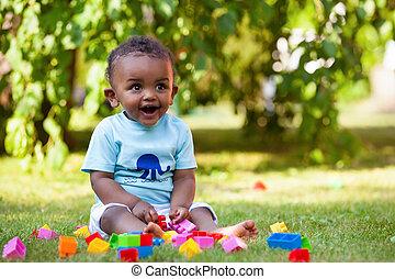 kevés, african american, csecsemő fiú, játék, alatt, a, fű
