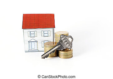 key and coins stack and paper house on white background