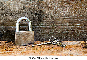 Key and lock on wooden background - Key and lock on wooden...
