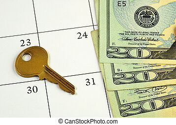 Key and money on a calendar
