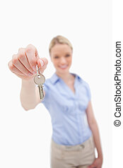 Key being handed over by woman