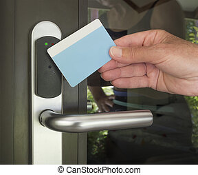 Key card security entry - hand touch keycard on hotel door