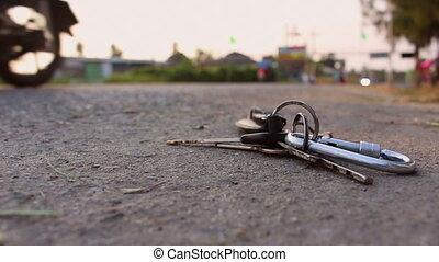 key chain on road