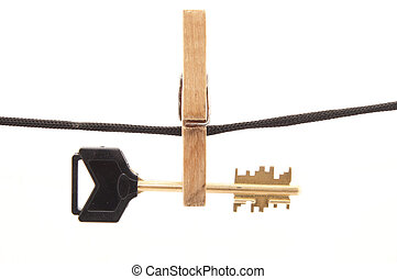 Key, clothespin and rope on a white background