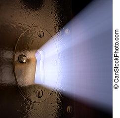 Key Hole - A close-up of light pouring out of a key hole.