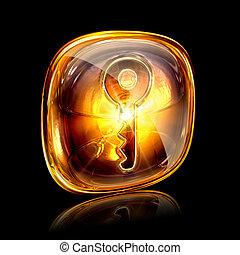 Key icon amber, isolated on black background