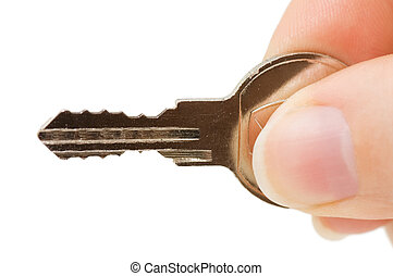 Key in a hand isolated on white background