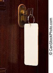Key in door lock - Key in a door lock featuring a blank...