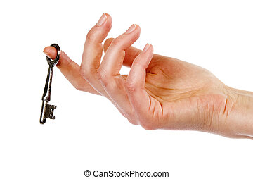 Key in Hand - A concept image of a womans hand holding a...