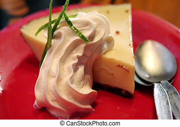 Key lime pie - Slice of florida key lime pie with whipped...
