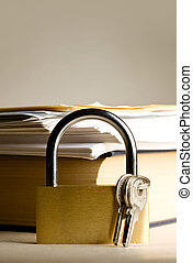 Key lock against the background of paper