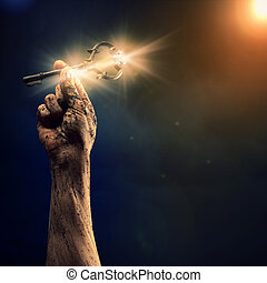 Key of success - Key in human hand. Struggle and success