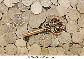 key on a heap of coins