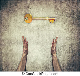 key - Closeup of two human hands offer a golden key to...