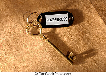 Key to happiness - Happiness label attached to a heart...