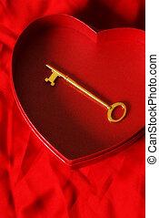 Key to my Heart - A key is placed inside a heart shaped box ...