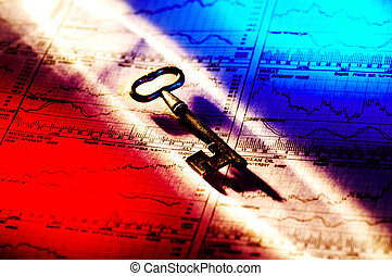Key To Success - Photo of a Key and Stock Charts With...