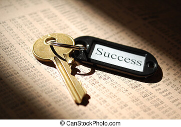Key to success - Sunlit key ontop of the financial section...
