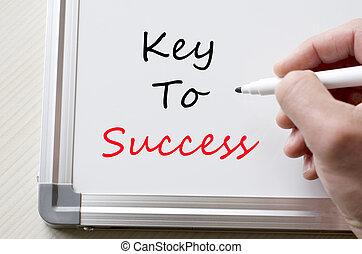 Key to success written on whiteboard