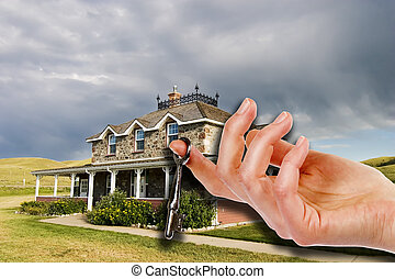 Key To The House - A hand holding a skeleton key in front of...