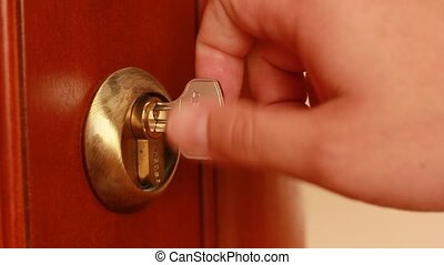 Key Unlock Open Door. Key sliding into lock and locking...