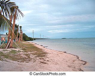 Key West Bridge - A beach looking back at the 7 mile bridge