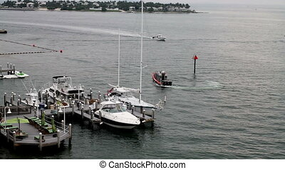 Key West Police Boat on Patrol and Leaving the scene