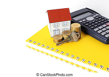 Key with coins stack and paper hous