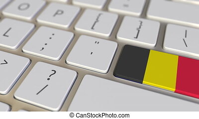 Key with flag of Belgium on the computer keyboard switches to key with flag of France, relocation related animation