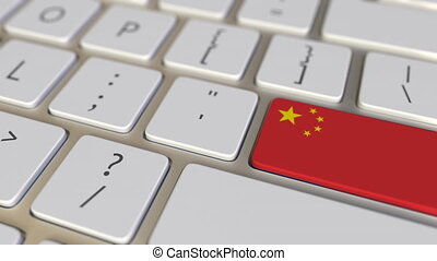 Key with flag of China on the computer keyboard switches to key with flag of the USA, translation or relocation related animation