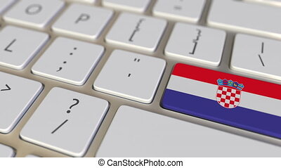 Key with flag of Croatia on the keyboard switches to key with flag of Germany, translation or relocation related animation