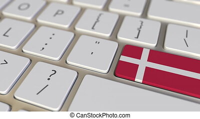 Key with flag of Denmark on the keyboard switches to key with flag of Germany, translation or relocation related animation
