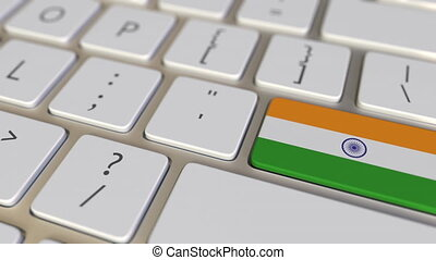 Key with flag of India on the keyboard switches to key with flag of Germany, translation or relocation related animation