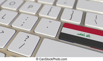 Key with flag of Iraq on the computer keyboard switches to...