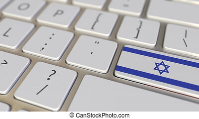 Key with flag of Israel on the computer keyboard switches to...