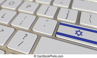 Key with flag of Israel on the keyboard switches to key with...