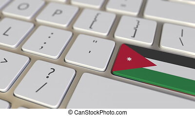 Key with flag of Jordan on the computer keyboard switches to key with flag of the USA, translation or relocation related animation