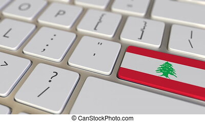 Key with flag of Lebanon on the computer keyboard switches to key with flag of the USA, translation or relocation related animation